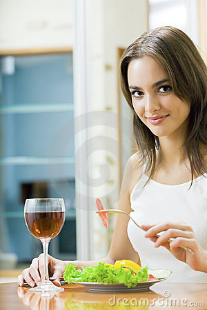 Woman with salad and redwine