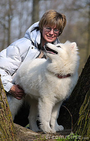 Woman and Samoed dog