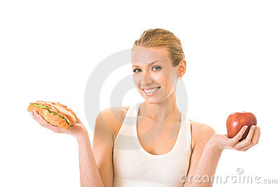 Woman with sandwich and apple