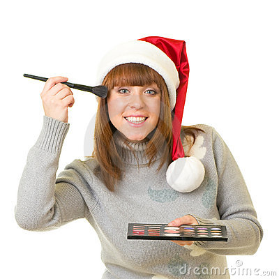 Woman in Santa Claus clothes with beauty cosmetics