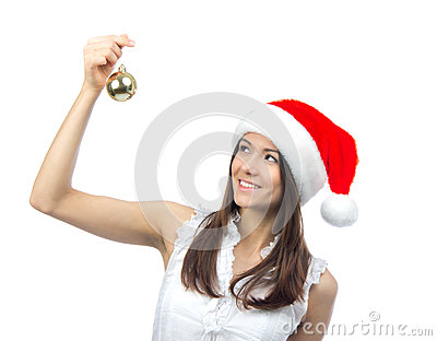 Woman in santa claus hat hold christmas ball
