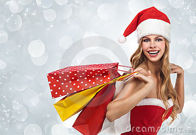 Woman in santa costume holding a shopping bags