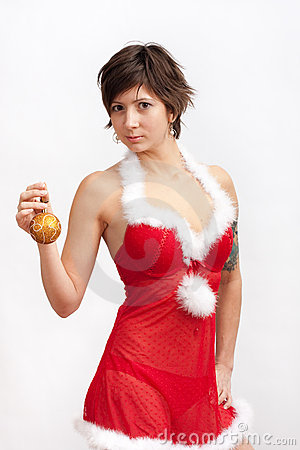 Woman in santa dress with christmas ball
