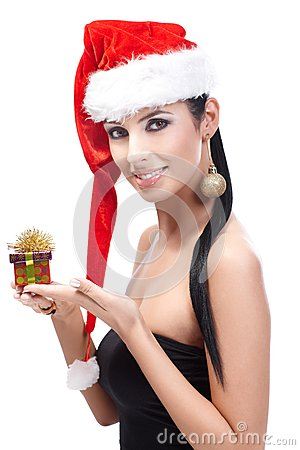 Woman in santa hat with Christmas present smiling