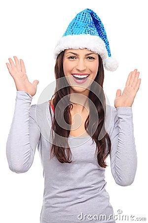 Woman in Santa hat gesturing