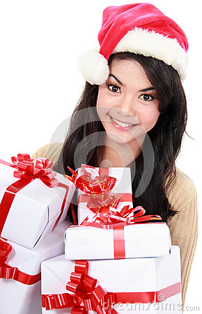 Woman in Santa hat holding Christmas gifts