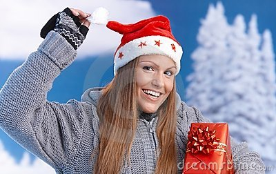 Woman in santa hat holding christmas present