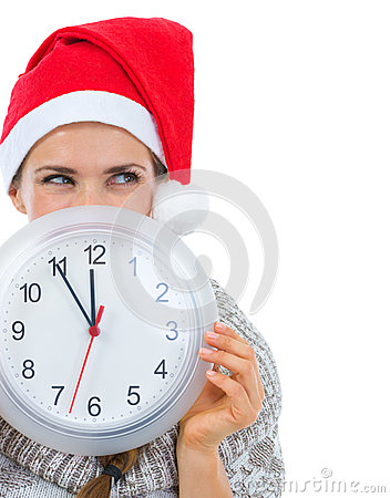 Woman in Santa hat holding clock
