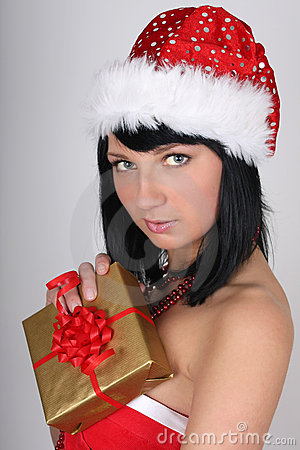 Woman in santa hat holding golden present