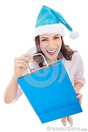 Woman in Santa hat holding shopping bag