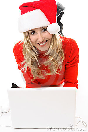 Woman in Santa hat with laptop