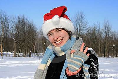 Woman in santa hat with okay