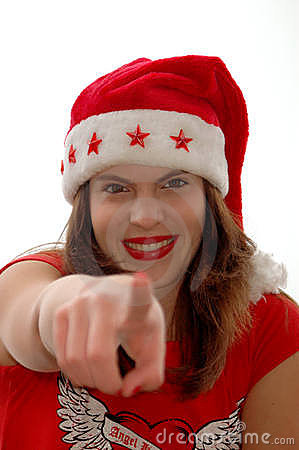 Woman in Santa hat pointing