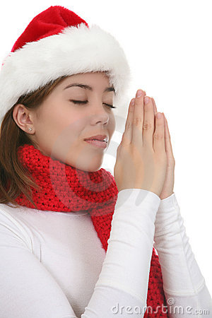 Woman in Santa hat praying