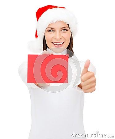 Woman in santa helper hat with blank red card