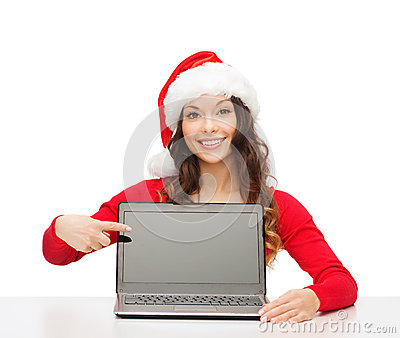 Woman in santa helper hat with laptop computer