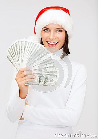 Woman in santa helper hat with us dollar money