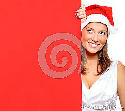 Woman in Santa s hat holding a blank board