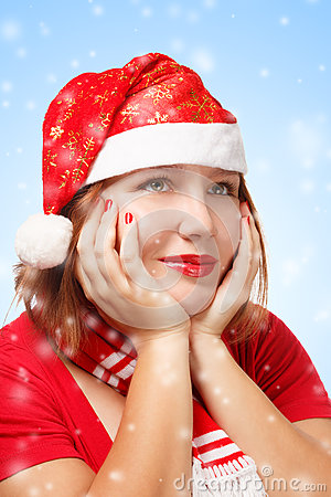 Woman in santa suit in thoughtful pose