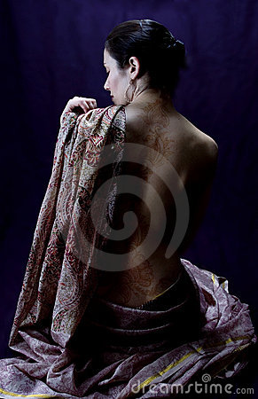 Woman in a sari with a henna tattoo