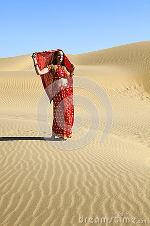 Woman in sari kissing a camel.