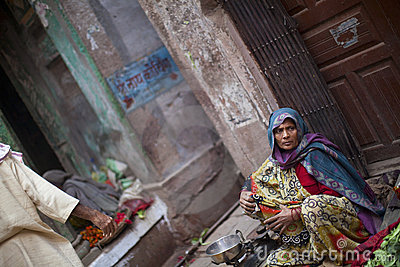 Woman in sari selling vegetables on the street in Editorial Stock Image