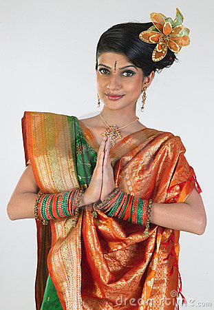Woman in sari with welcome posture