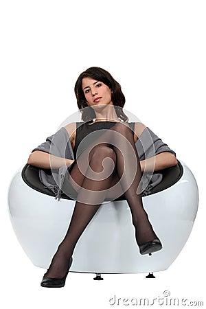 Woman sat in evening dress