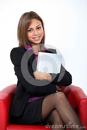 Woman sat in red chair