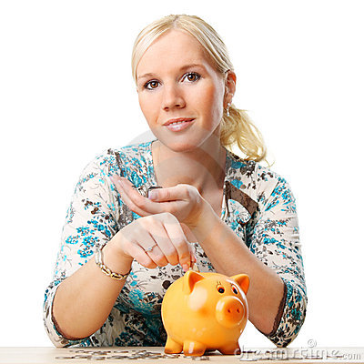 Woman saving her money in piggy bank.