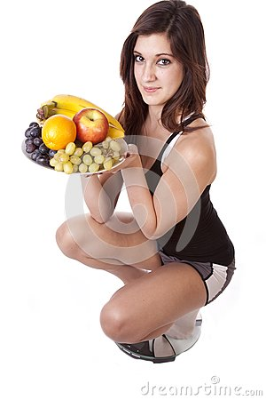 Woman On Scale With Fruit Happy
