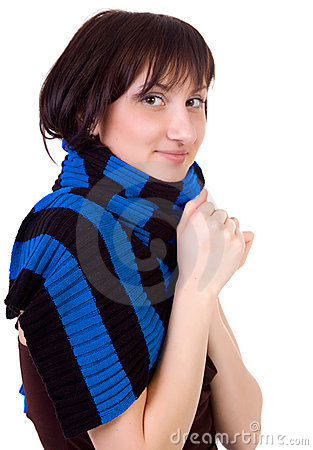 The woman in a scarf is feel cold.