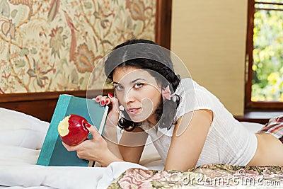 Woman in schoolgirl hold bited apple