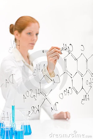 Woman scientist write chemical formula