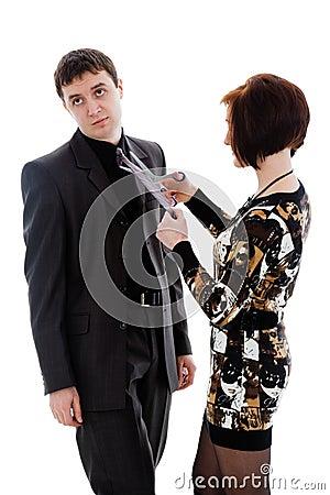 Woman scissor tie, young man.