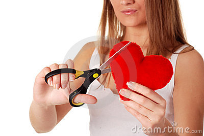 Woman with scissors and red heart