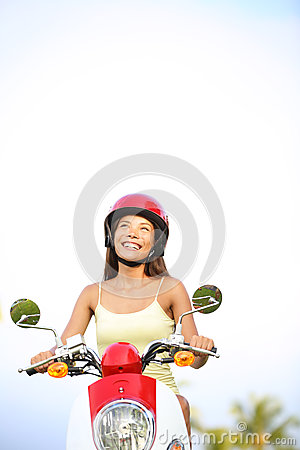 Woman on scooter thinking looking