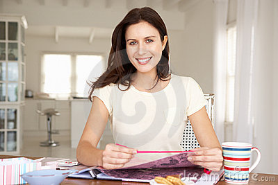 Woman scrapbooking at table