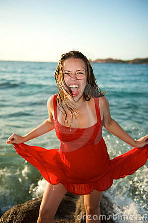 Woman screaming on the beach
