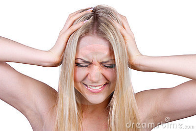 Woman screaming while covering her ears