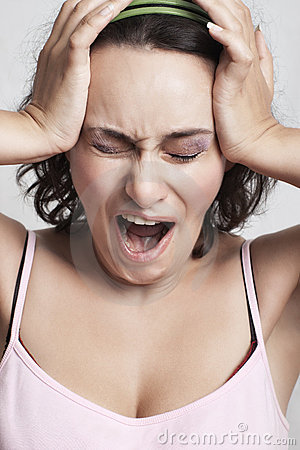 Woman screaming from headache