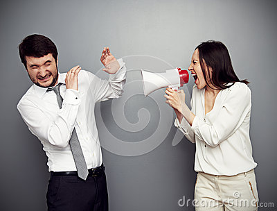 Woman screaming in megaphone at the man