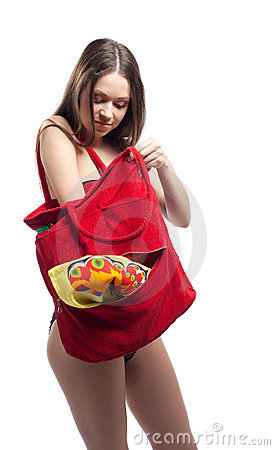 Woman search towel in red beach bag isolated