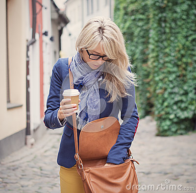 Free Woman Searching For Stuff In Her Handbag. Stock Photos - 44176453