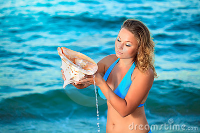 Woman with seashell