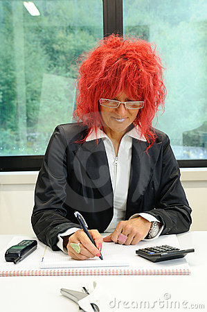 Woman secretary with red hair