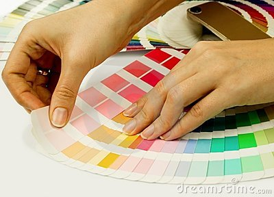 Woman selecting color from Pantone swatches