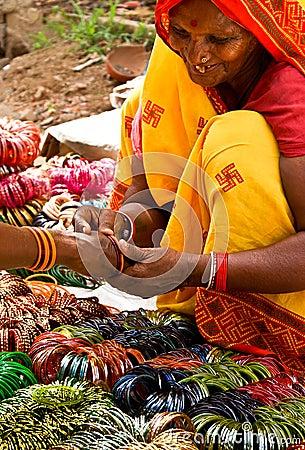 Woman selling bangles Editorial Stock Image