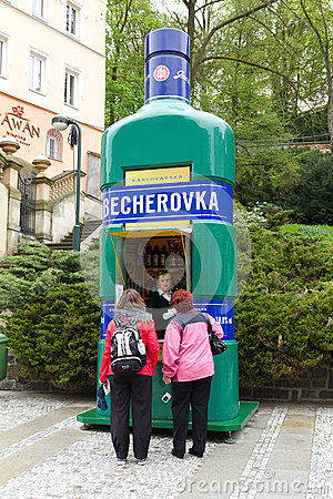 Woman selling famous beverage Becherovka Editorial Image
