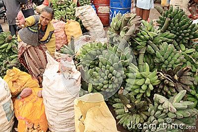 A woman selling potatoes and banana on Timor Editorial Photo